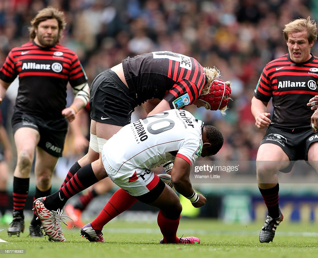 Centre Mathieu Bastareaud of Toulon goes down following a big tackle from lock Mouritz Botha of Saracens during the Heineken Cup semi final between Saracens and Toulon at Twickenham Stadium on April 28, 2013 in London, United Kingdom.