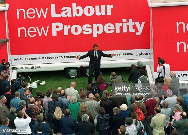 Centre stage of New Labour as Party Leader Tony Blair unveils new posters putting across the Labour Party message in front of constituents at Trimdon...