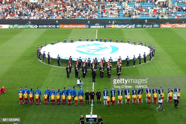 Centrecircle ball boys and girls encircle the UEFA logo as the teams line up