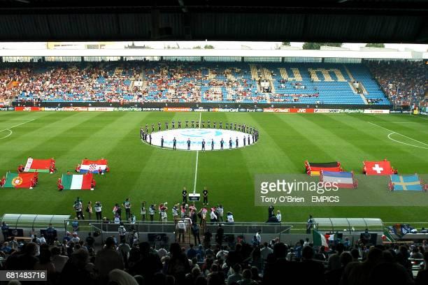 Centrecircle ball boys and girls encircle the UEFA logo