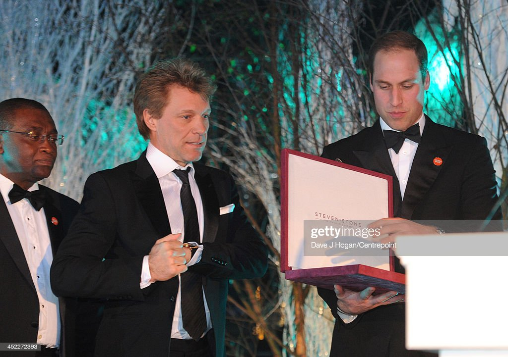 Centrepoint Chief Executive Seyi Obakin, Centrepoint Chief Executive (L), Jon Bon Jovi (C) and Prince William, Duke of Cambridge attend the Winter Whites Gala In Aid Of Centrepoint on November 26, 2013 in London, England.