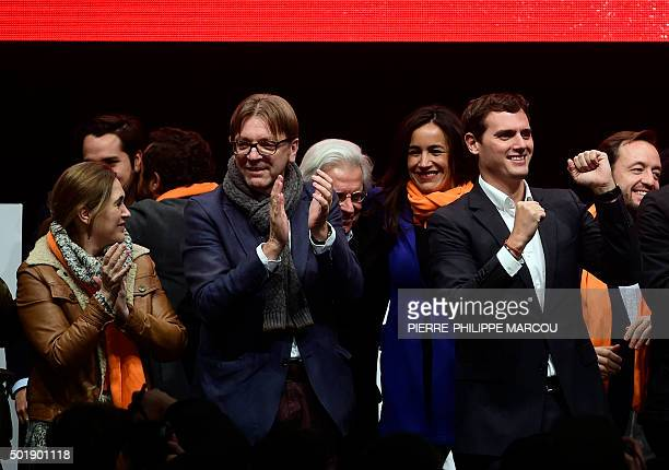 Centreright party Ciudadanos leader and candidate for the upcoming December 20 general election Albert Rivera gestures next to Ciudadanos' member...