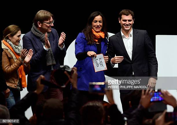 Centreright party Ciudadanos leader and candidate for the upcoming December 20 general election Albert Rivera smiles next to Ciudadanos' member...