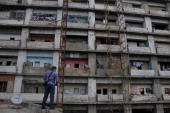 Centro Financiero Confinanzas or Tower of David is an unfinished and abandoned skycraper downtown Caracas wich was squattered in 2007 The government...