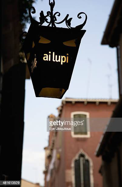 Centro Storico Lantern outside restaurant inscribed with ai lupi reference to Dantes use of wolves as metaphor in the Inferno