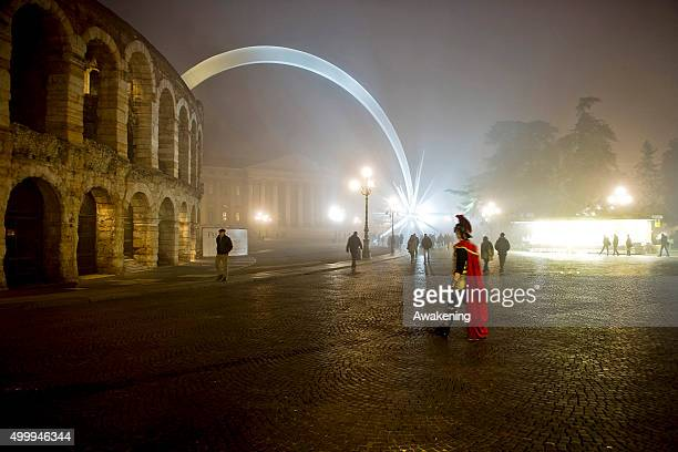 A centurion impersonator walks near the Arena on December 4 2015 in Verona Italy Christmas markets fairs lights and nativity scenes fill Northern...