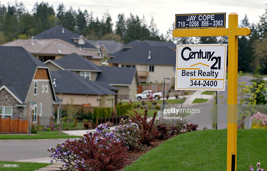 Century 21 realty sign is posted in the front yard of a home in Eugene Oregon Tuesday April 2007 Sales of previously owned homes fell to the lowest...