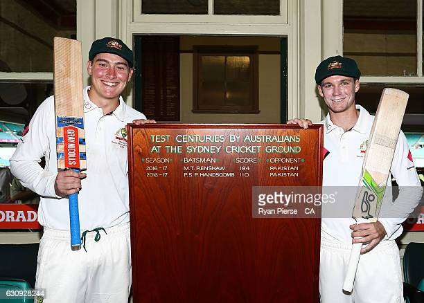 Century makers Matt Renshaw and Peter Handscomb of Australia pose with the new SCG Honour Board after day two of the Third Test match between...