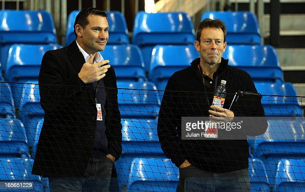 Ceo Roger Draper and ex tennis player Jeremy Bates have a chat during day one of the Davis Cup match between Great Britain and Russia at the Ricoh...