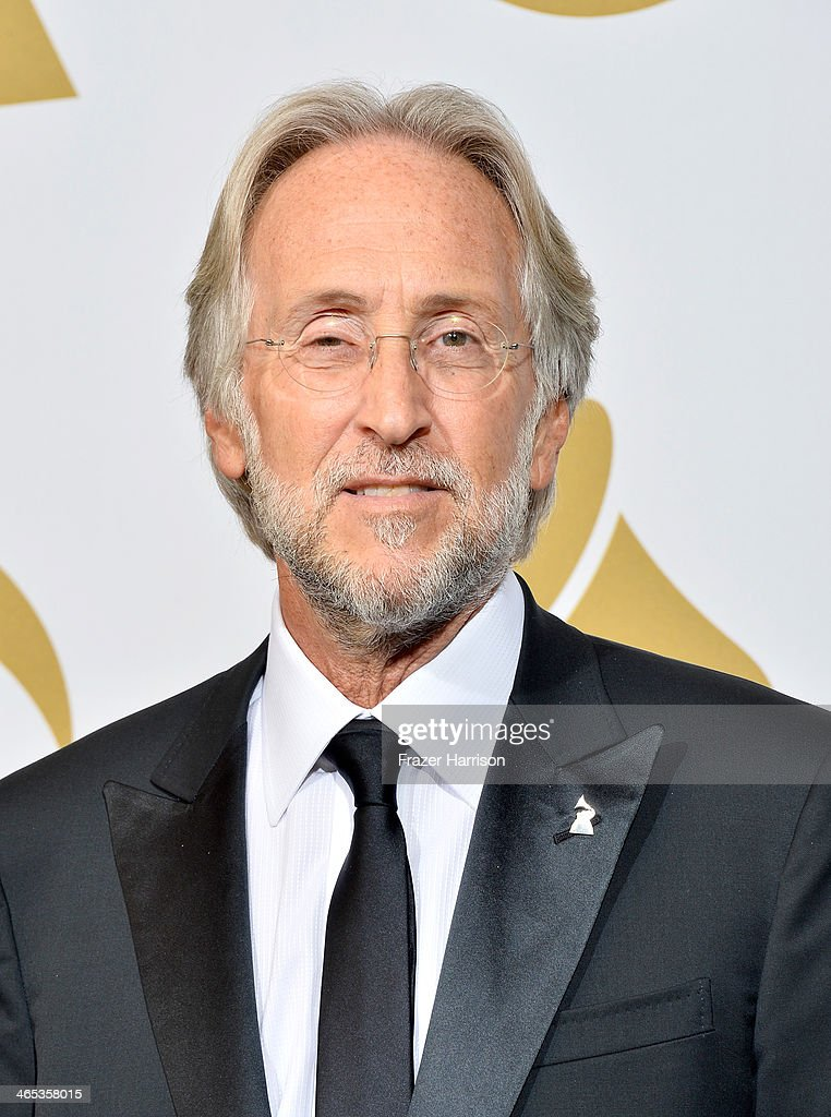 President of the National Academy of Recording Arts & Sciences Neil Portnow poses in the press room during the 56th GRAMMY Awards at Staples Center on January 26, 2014 in Los Angeles, California.