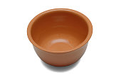 Ceramic bowl for sauces or soups of brown color isolated on a white background