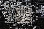 Ceramic Capacitors at Digital electronic circuit board closeup very small type