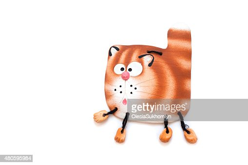 Ceramic figurine of a cat hung on the wall : Stock Photo