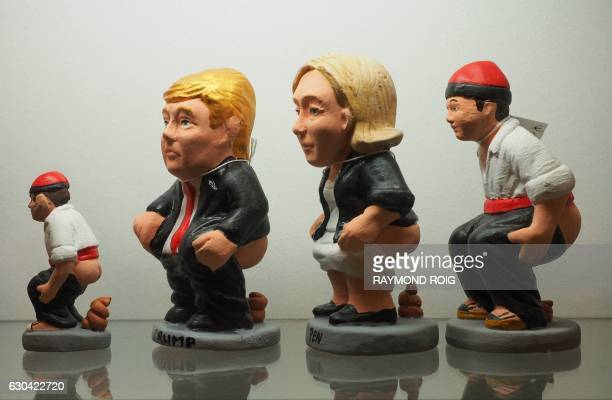 Ceramic figurines called 'caganers' representing US presidentelect Donald Trump and president of French farright Front National party and candiate...