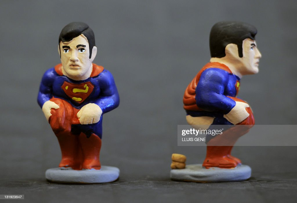Ceramic figurines, known locally as caganers, of cartoon character Superman are displayed on November 8, 2011. Statuettes of well-known people defecating are a strong Christmas tradition in Catalonia, dating back to the 18th century as Catalonians hide caganers in Christmas Nativity scenes and invite friends to find them. The figures symbolize fertilization, hope and prosperity for the coming year.