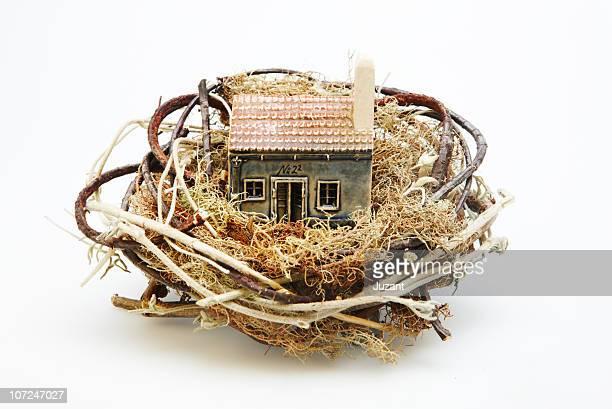 Ceramic house in a nest