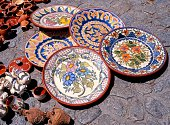 Decorative Ceramic plates and pots on floor, Evora, Alentejo Region, Portugal, Western Europe.