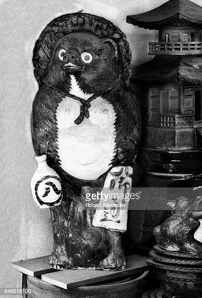 A ceramic tanuki or racoon dog for sale at a garden shop in Tokyo Japan The tanuki appears frequently in Japanese fairytales and folklore