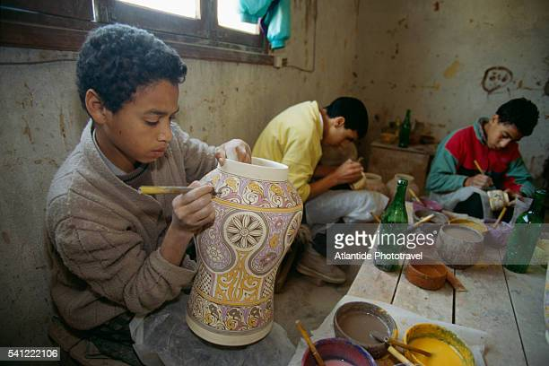 Ceramic Workers Painting Vases