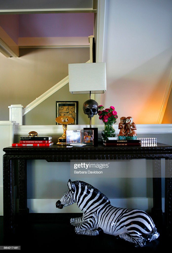 A Ceramic Zebra Sits Under A Chinese Console Table With A Bronze Skull Lamp  From Blackman And Cruz Pictures | Getty Images