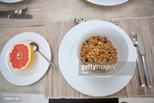 Cereal and grapefruit breakfast on table : Stock Photo
