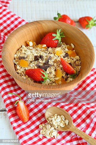 Cereal with fruit in a wooden bowl : Stock Photo