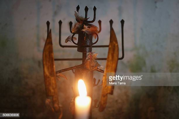 A ceremonial candle is lit during a Candomble ceremony on January 24 2016 in Itaborai Brazil Candomble is an AfroBrazilian religion whose...