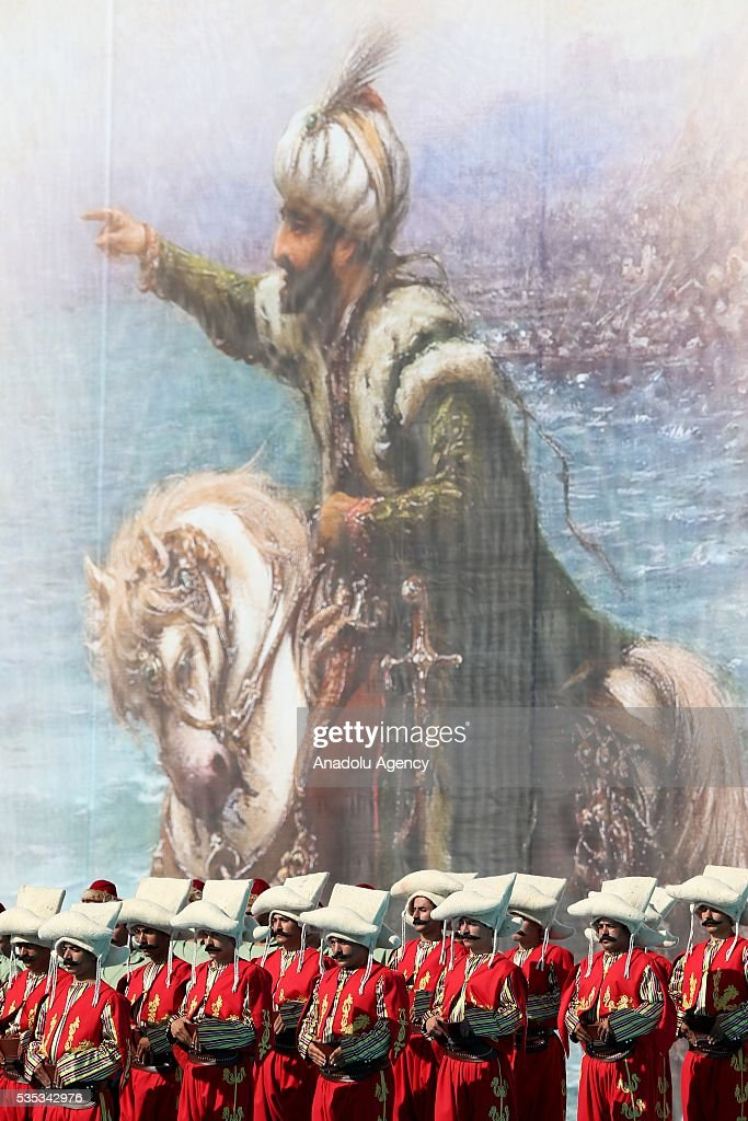 Ceremonial Ottoman Janissary Band stand in front of a painting of Ottoman Sultan Mehmed II (Mehmet the Conqueror) during the celebrations of the 563rd anniversary of Istanbuls conquest by Turks at Yenikapi Event Area in Istanbul, Turkey on May 29, 2016. On May 29, 1453, Ottoman Sultan Mehmed II (Mehmet the Conqueror) conquered Istanbul, then called Constantinople, from where the Byzantines had ruled the Eastern Roman Empire for more than 1,000 years. The conquest transformed the city, once the heart of the Byzantine realm, into the capital of the new Ottoman Empire.