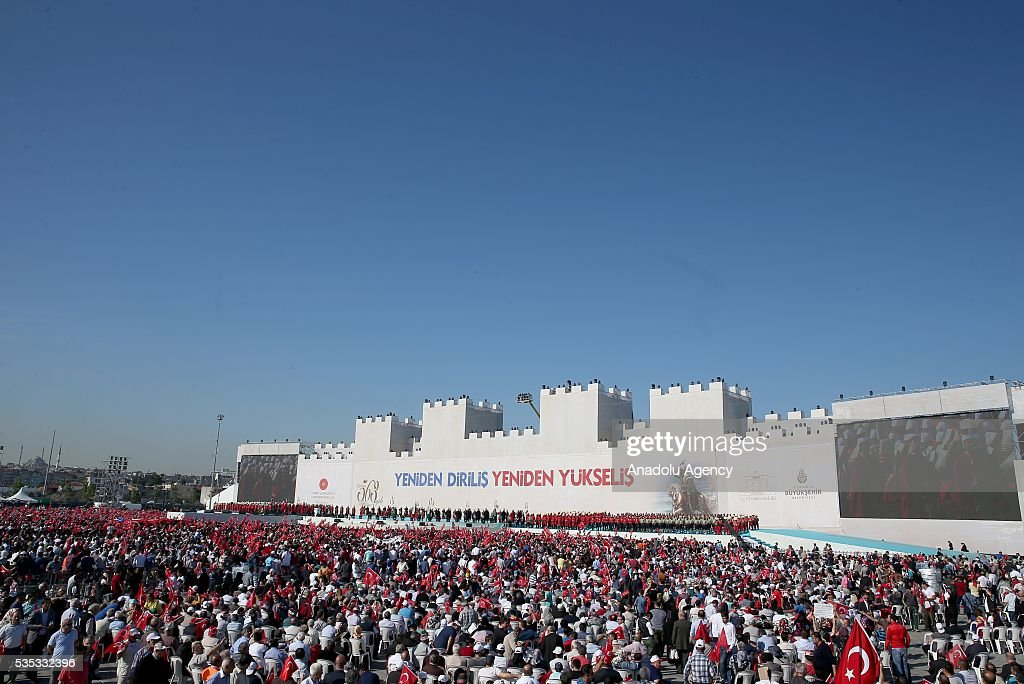 Ceremonial Ottoman Janissary Band stand in front of the giant model of a part of Istanbul's historical city walls during the celebrations of the 563rd anniversary of Istanbuls conquest by Turks at Yenikapi Event Area in Istanbul, Turkey on May 29, 2016. On May 29, 1453, Ottoman Sultan Mehmed II (Mehmet the Conqueror) conquered Istanbul, then called Constantinople, from where the Byzantines had ruled the Eastern Roman Empire for more than 1,000 years. The conquest transformed the city, once the heart of the Byzantine realm, into the capital of the new Ottoman Empire.