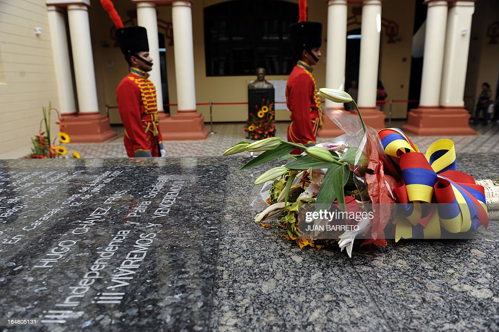 Ceremonial soldiers guard the remains of late Venezuelan President Hugo Chavez Mountain Barracks (Cuartel de la Montana) in the 23 de Enero low income neighborhood in Caracas, on March 28, 2013.