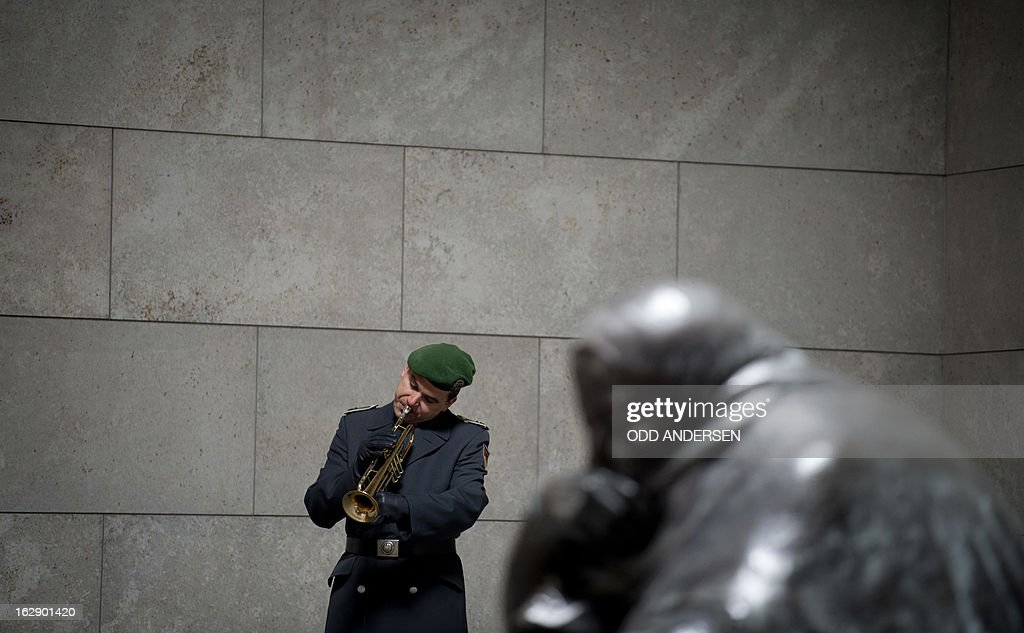A ceremonial trumpet player gets ready for an wreath laying ceremony by Italian President at the 'Neue Wache' memorial for victims of conflict and war in Berlin on March 1, 2013.