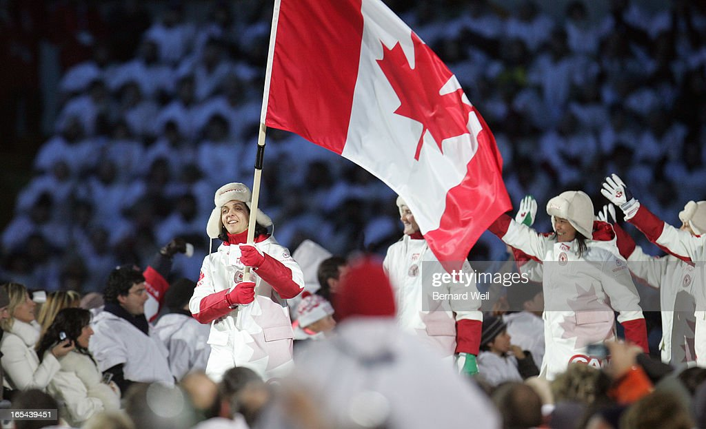 CEREMONIES---02/10/06---Danielle Goyette carries in the flag at Opening Ceremonies for the Torino 2006 XX Winter Olympics hosted by Turin, Italy , February 10, 2006. (Bernard Weil/Toronto Star) sjr