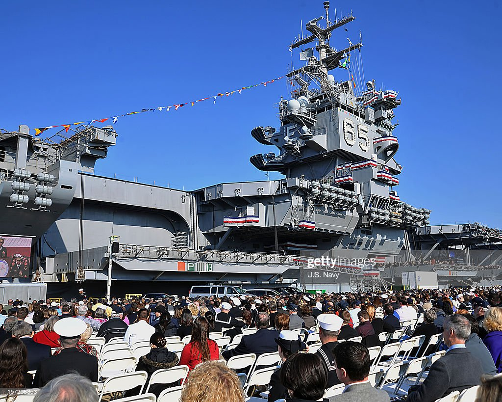 Ceremony attendees observe the inactivation ceremony of the aircraft carrier USS Enterprise (CVN 65) on December 1, 2012 in Norfolk Virginia. Enterprise was commissioned in 1961 and is scheduled to celebrate her inactivation after 51 years of service. (Photo by U.S. Navy photo by Mass Communication Specialist 2nd Class (SW/AW) Nick C. Scott/U.S. Navy via Getty Images)