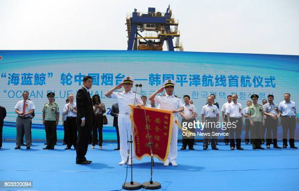 A ceremony is held before China's domestically designed large passenger container ship Ocean Blue Whale makes its maiden voyage at Yantai Port on...