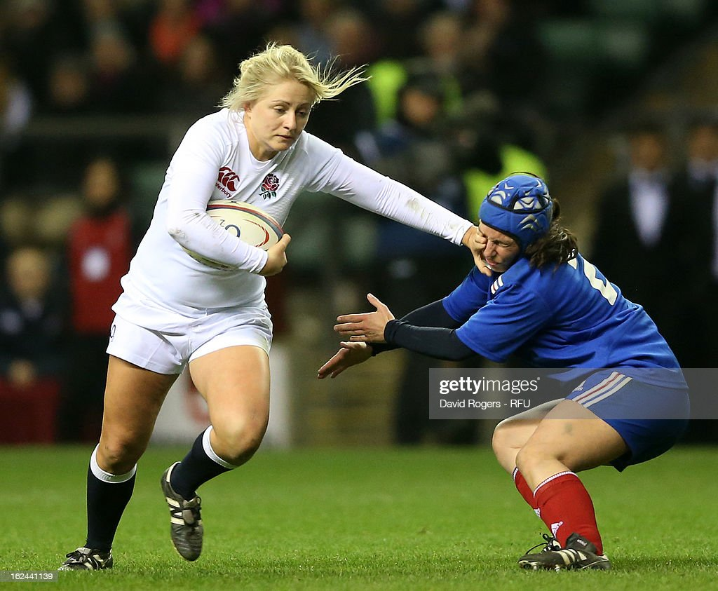 Ceri Large of England holds off Laetitia Salles of France during the Women's RBS Six Nations match between England and France at Twickenham Stadium on February 23, 2013 in London, England.