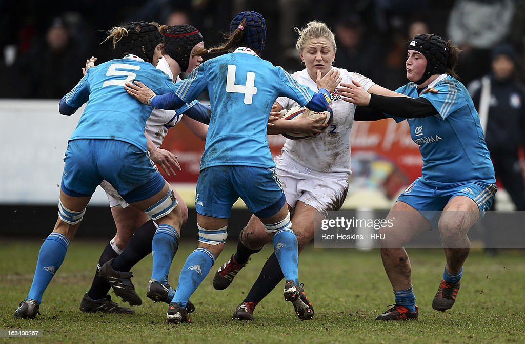 Ceri Large of England runs at the Italian defence during the Women's RBS Six Nations match between England and Italy at Esher Rugby Club on March 09, 2013 in Esher, England.