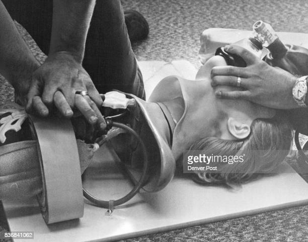 Cernich Does CPR while Martin Continues use of Ambu Bag Credit Denver Post Inc