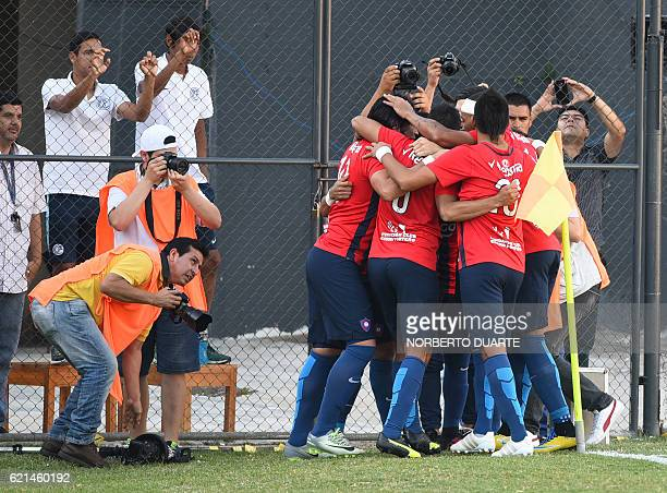 Cerro Porteno's players celebrate after Cecilio Dominguez scored against Olimpia during their Paraguayan Clausura 2016 football tournament match at...