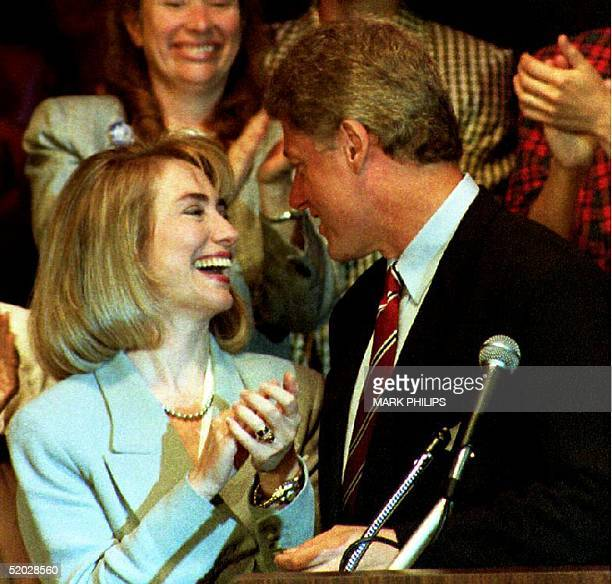 Certain Democratic presidential nominee Bill Clinton is applauded by his wife Hillary 14 July 1992 before his address to the Women's Caucus of the...