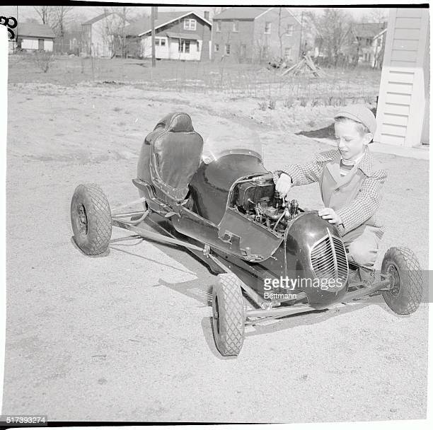 Certainly a big man in his neighborhood is eightyearold Joe Fisher of Cleveland owner of a midget racing car made by his father from old metal and...