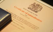 A certificate of British naturalisation is pictured during a citizenship ceremony at Wembley Stadium on October 5 2007 in London England Lord...