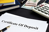 Certificate of deposit and pen in the office.