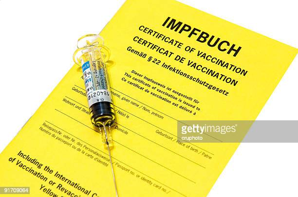 Certificate of vaccination with Influenza injection isolated on white