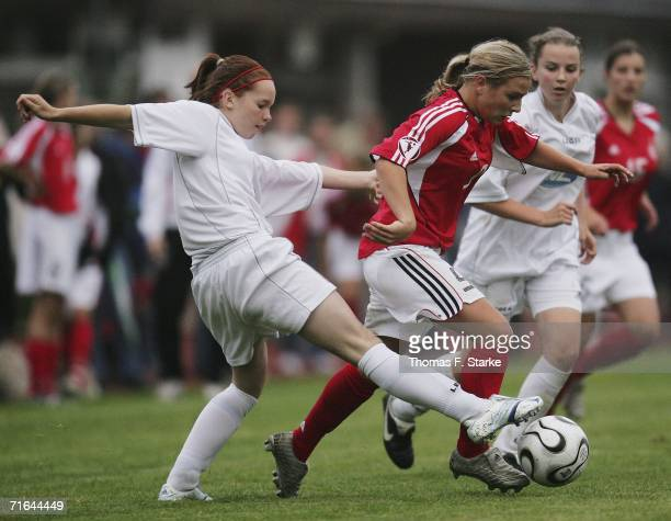 Cerys Llewellyn of Wales Svenja Huth of Germany and Kate Edwards of Wales in action during the Women's Under 15 match between Germany and Wales on...