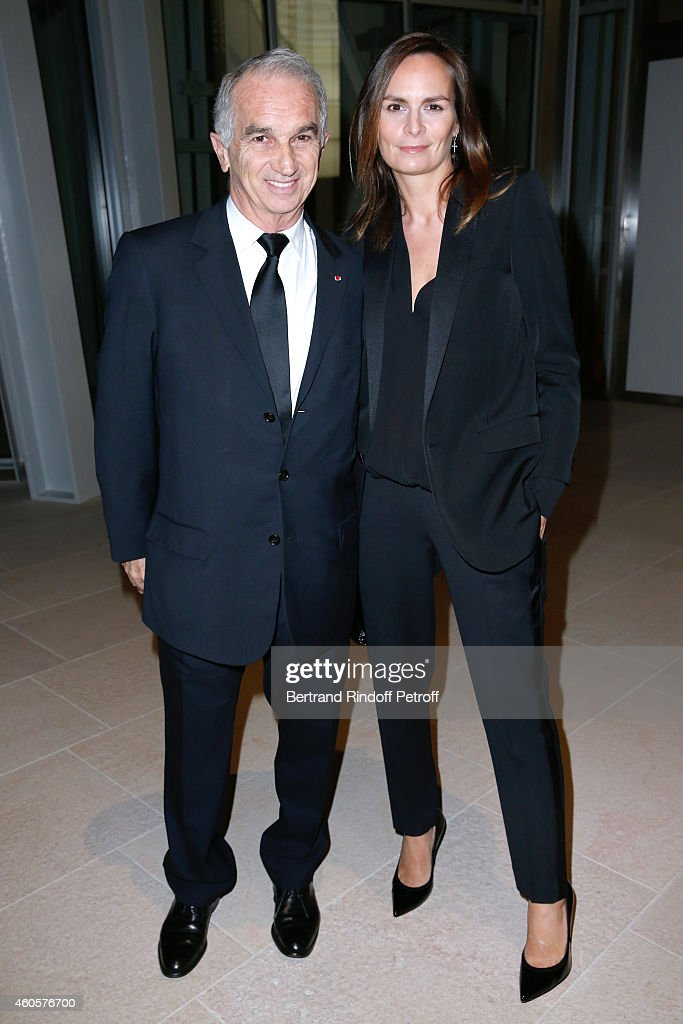 Cesar Academy President Alain Terzian and his wife Brune de Margerie attend the 'Fondation Claude Pompidou' : Charity Party at Fondation Louis Vuitton on December 16, 2014 in Paris, France.