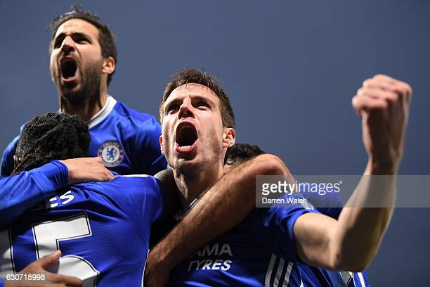 Cesar Azpilicueta and Cesc Fabregas of Chelsea celebrate their side's second goal scored by Willian during the Premier League match between Chelsea...