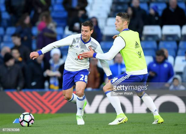 Cesar Azpilicueta and Gary Cahill of Chelsea warm up prior to the Premier League match between Chelsea and Southampton at Stamford Bridge on April 25...