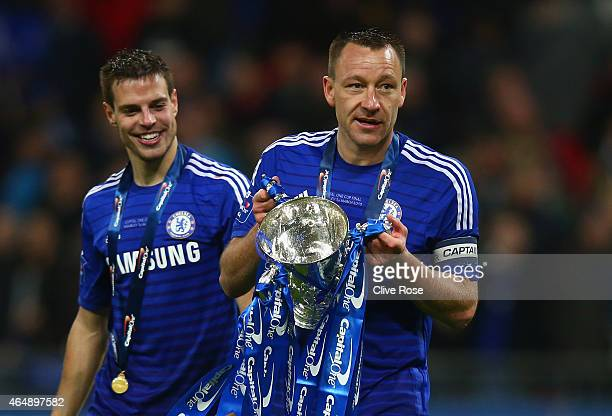 Cesar Azpilicueta and John Terry of Chelsea celebrate with the trophy during the Capital One Cup Final match between Chelsea and Tottenham Hotspur at...