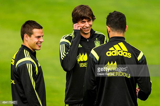 Cesar Azpilicueta Ander Iturraspe and Raul Albiol of Spain chat during a training session at Ciudad del Futbol on May 28 2014 in Las Rozas de Madrid...