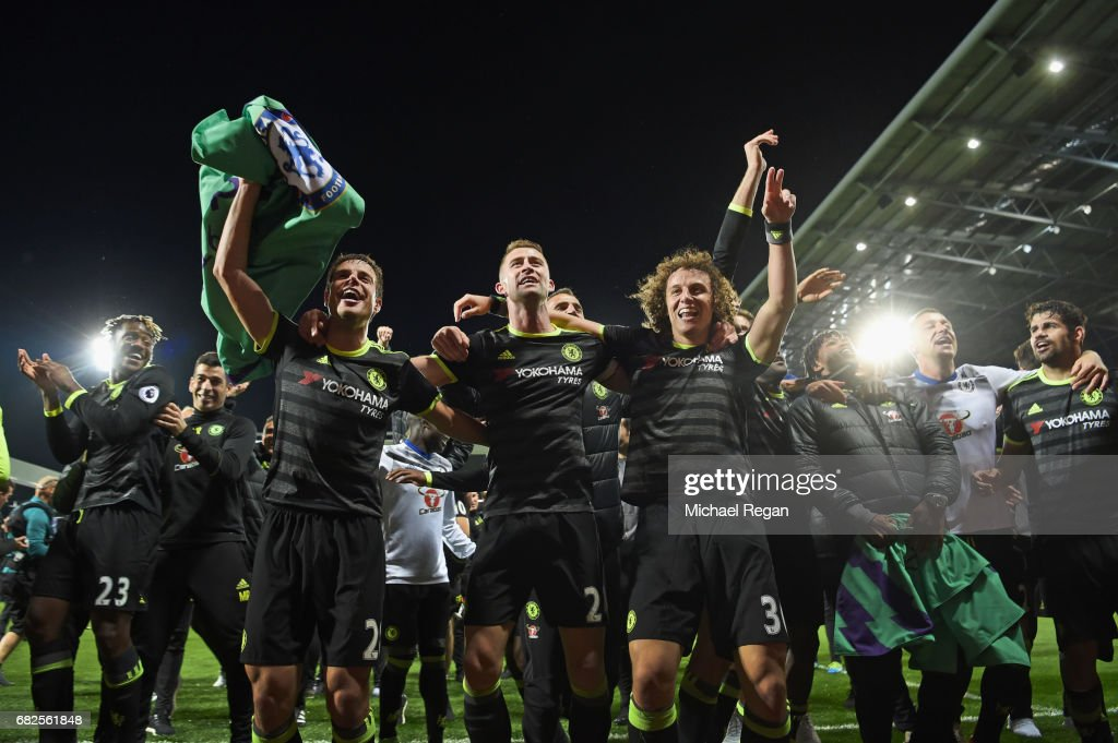 Cesar Azpilicueta, Gary Cahill and David Luiz celebrate winning the league after the Premier League match between West Bromwich Albion and Chelsea at The Hawthorns on May 12, 2017 in West Bromwich, England. Chelsea are crowned champions after a 1-0 victory against West Bromwich Albion. Restrictions